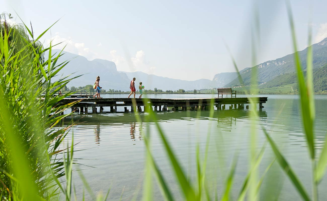 A wooden jetty on Lake Caldaro in Alto Adige