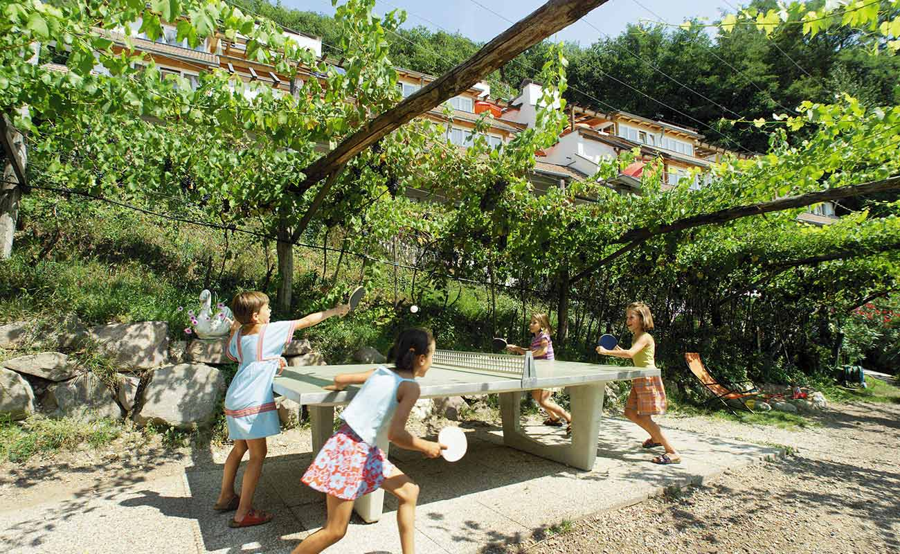Children play ping pong in the vineyards